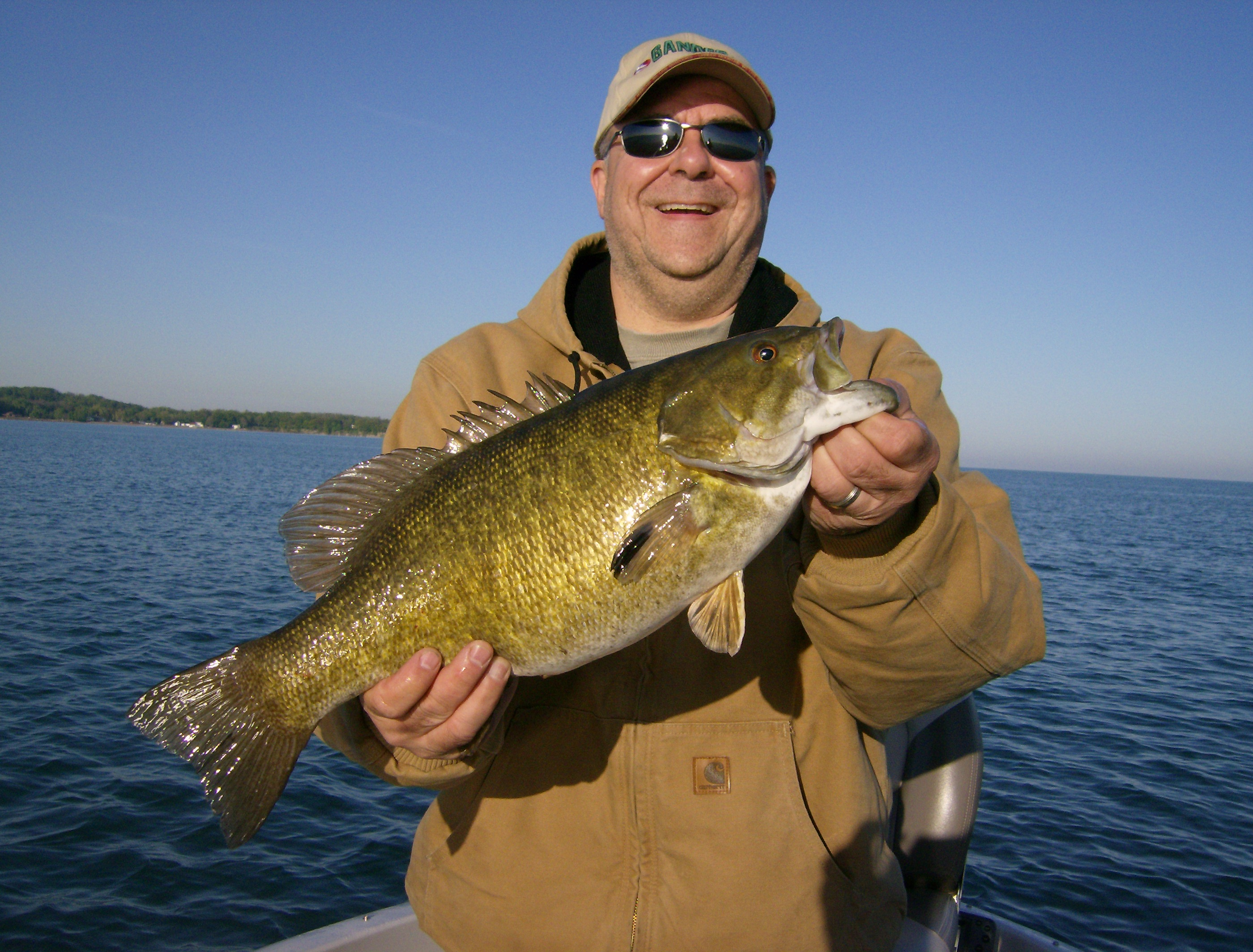 Happy Customer with an early season Lake Erie 5lb smallmouth bass